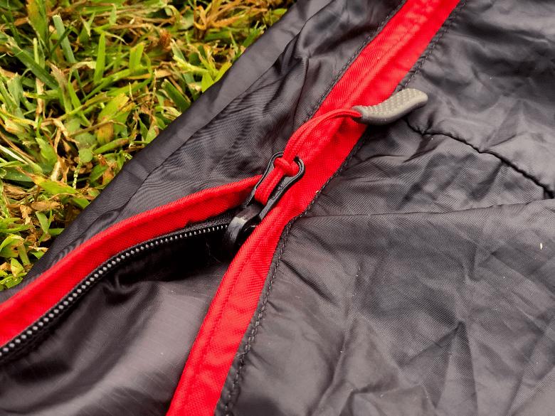 Close up of sleeping bag zipper.
